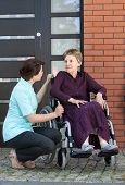 picture of wheelchair  - Vertical view of nurse talking with senior woman on wheelchair - JPG