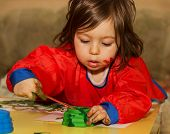 stock photo of daycare  - Cute little child drawing and studying at daycare - JPG