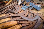 foto of scythe  - Old rusted scythes for sale on the market in Madagascar - JPG