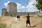 stock photo of macedonia  - Tourists taking photo in Platamonas  - JPG