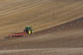 stock photo of four-wheel drive  - Large Modern Four Wheel Drive Tractor Ploughing with Disk Harrow in Stubble Field - JPG