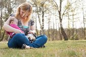 stock photo of puppies mother dog  - Mother is having a trip with the baby and dog outside