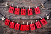 pic of christmas greetings  - Happy Holidays Greetings on red Tags Hanging on a Line with Snowflakes Christmas or Winter Background - JPG