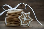 stock photo of ginger bread  - Ginger Breads with white Bow and Decorated Star as Food or Winter or Christmas Background with Copy Space - JPG