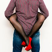 stock photo of red back  - legs of the girl hugging a man - JPG