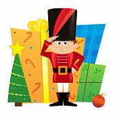 stock photo of nutcracker  - Cute nutcracker is standing in front of a pile of Christmas presents - JPG