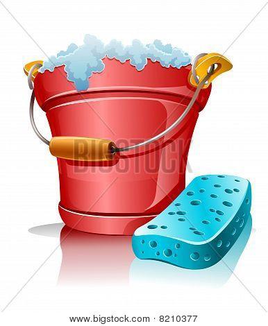 bucket with foam and bath sponge