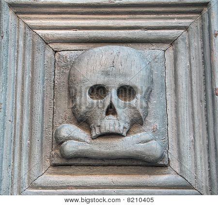 Portal with skull. Purgatory Church. Matera. Basilicata.