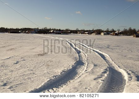 Tractor Tracks In Winter Field