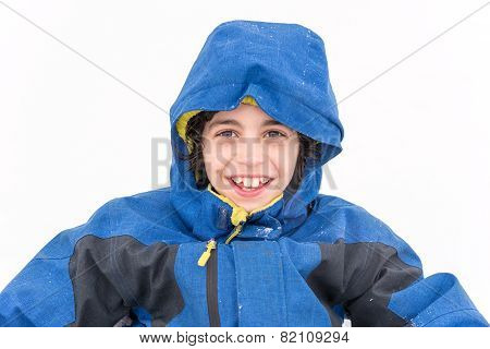 Cute Child Boy Portrait In The Snow