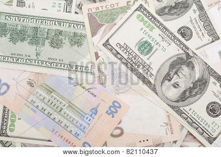 The Many Dollars And Ukrainian Money. Money Background