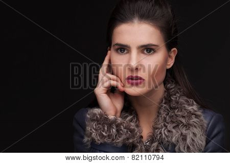 young brunette woman studio portrait in fur