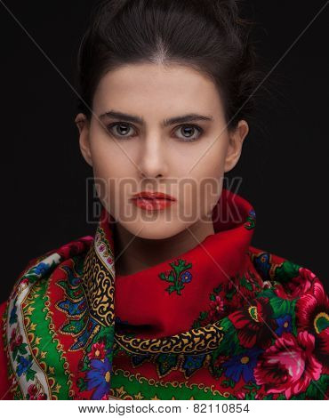 young russian brunette woman studio portrait