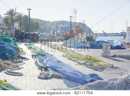 Nets On Pier. Fishing Boat Arrived In Port - Series.