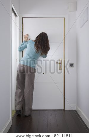 Back Woman Looking At Peephole