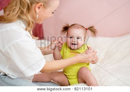 Happy mother  and baby have fun pastime