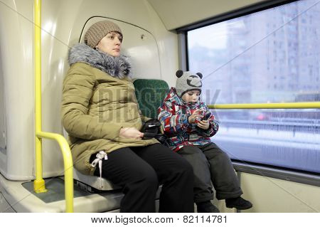 Mother With Son In The Bus