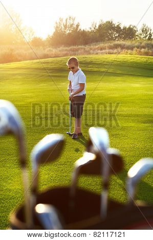 Casual Kid At A Golf Field Holding Golf Club