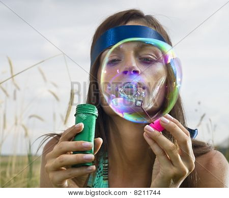 Face Of Woman That Blows Soap Bubbles