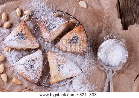 Hamantaschen cookies for Purim with sugar powder