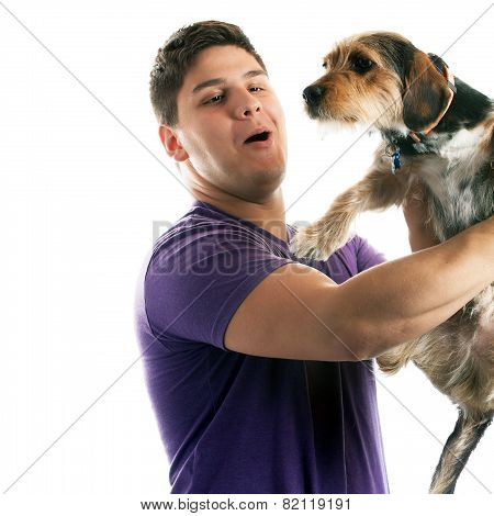 Man Holding His Pet Dog