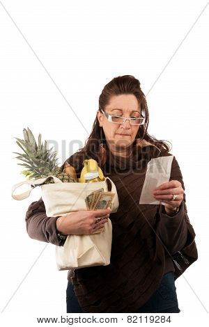 Grocery Shopper Reviewing Receipt