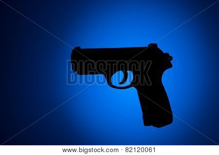 Handgun Silouette With Blue And Black Background