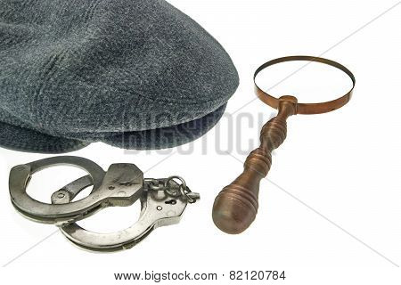 Warm Cap With Earflaps, Magnifying Glass And Handcuffs