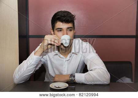 Stressed Handsome Man Having a Cup of Coffee at the Cafe