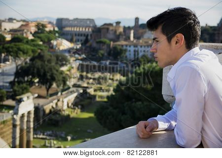 Serious Man on Terrace Looking at Outdoor View in Rome, Italy