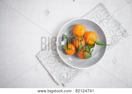 Tangerines On White Wooden Background. Grey Napkin