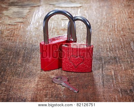 Red Locks With Hearts And Key On Grunge Old Background