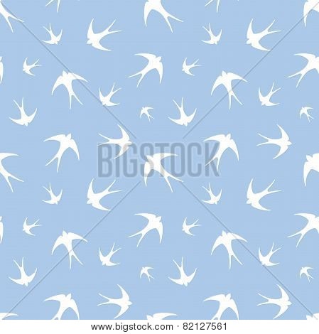 Seamless pattern with white swallows on blue. Vector illustration.