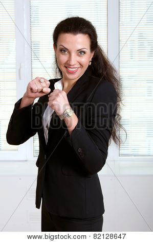 Womanin Black Business Suit Stands Like A Boxer