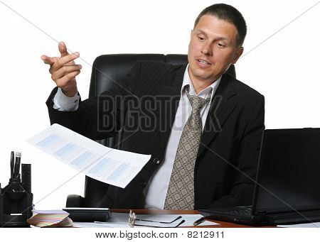 The Businessman Discontentedly Throws The Financial Report