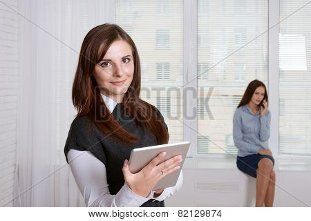 Woman Looking For Information In Her Tablet In The Foreground