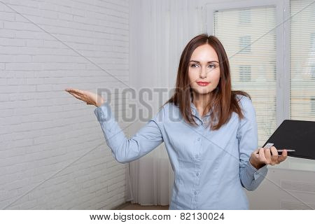 Woman Holding A Folder Expressing Bewilderment