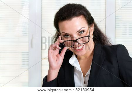 Girl In Business Attire Looking Over His Glasses And Laughs