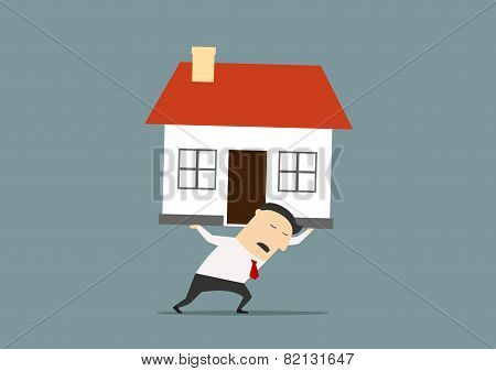 Businessman carrying a house on his back