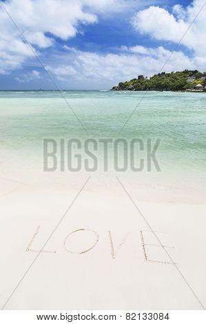 The Word Love On A White Beach