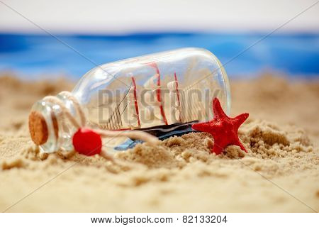 Sea concept composition with bottle and seashell