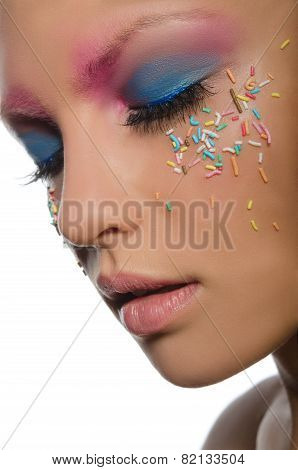 Woman With Confectionery Decorations On Face