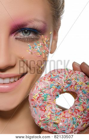 Woman With Color Decorations On Face And Donut