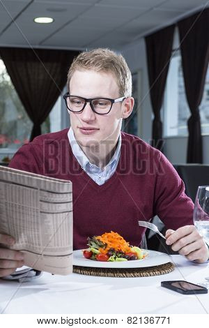 Businessman Eating At A Restaurant.