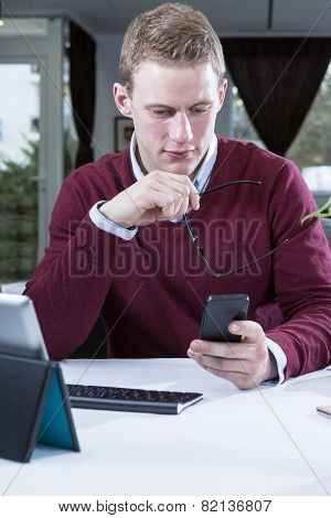 Businessman Looking The Mobile Phone .