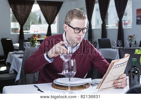 Businessman Reading At A Restaurant .