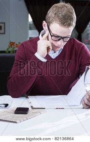 Businessman Reading The Menu.