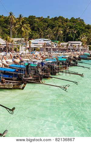 Longtail Boats In Tropical Island