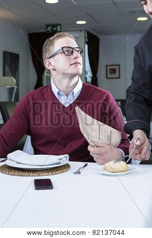 Young Businessman At A Restaurant.