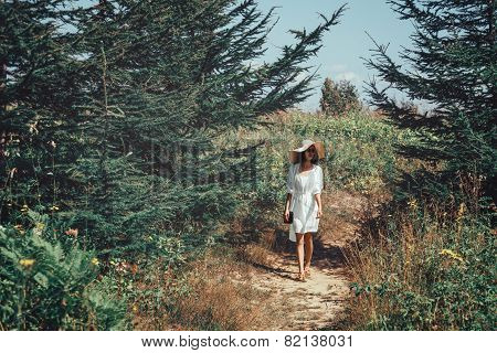 Beautiful Woman Walking On Summer Nature